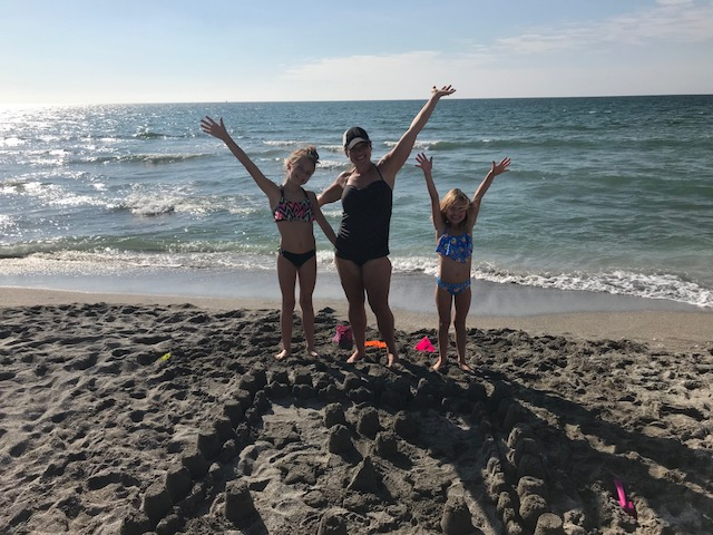 Carly at the beach with family